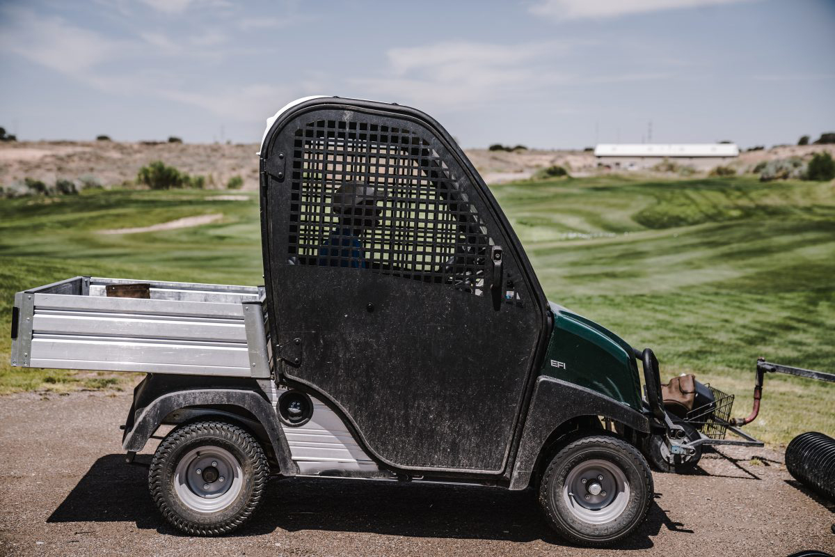 driving a golf cart on a course